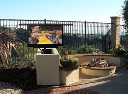 sunbrite outdoor television installed in a stucco lift cabinet