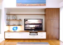contemporary display and entertainment unit with floating shelving designed to fit wall to wall into recessed niche five cd drawers two small cupboards