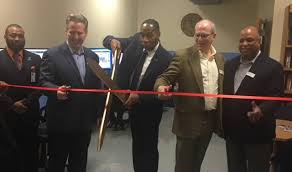 MCVET Executive Director Jeffery Kendrick, cuts the ribbon opening ...