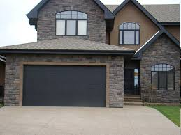 6 Fabulous Custom Black Garage Doors Also Stone Wall House With Arch Windows  Design