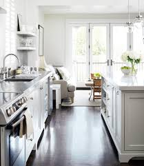 amazing open floor plan kitchen design with creamy white kitchen cabinets with stainless steel countertops chunky white floating shelves white kitchen