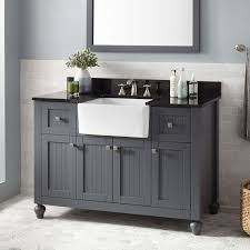 this style of vanity features a combination of delicate carvings louvered panels and bead board which help to embrace classic farmhouse style appeal