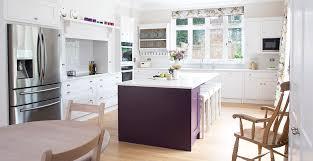 white quartz worktop colourful cabinetry