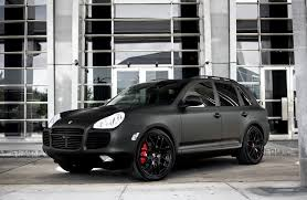 porsche panamera turbo custom. customized porsche cayenne turbo s with full matte black exterior wrap smoked lights painted trim lowered on 22u2033 imola wheels panamera custom