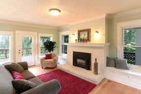 traditional living room with window seats painted stone fireplace safavieh california red area
