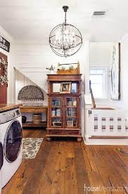 doing laundry for a large family is a little less stressful thanks to this oversized laundry room adorned with a beautiful chandelier and shiplap walls