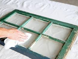 wipe away dust and debris from window panes with a dry cloth