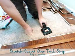 stretch carpet over tack strip after laying and installing laminate flooring yourself