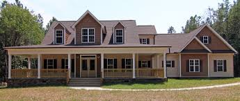 a spacious front porch wraps around this modern farmhouse style raleigh custom home built by stanton homes