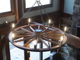 i like this one a lot if we decide to go with candles irish throughout wagon cool wagon wheel chandelier