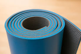 the gaiam athletic duramat rolled up in blue close up of top
