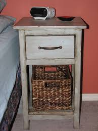 vintage tall white bedside table with storage drawer and shelf plus sea grass basket stunning