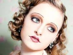20 s makeup using bronzes and blushes to create a smokey eye