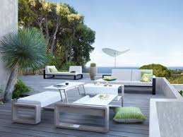 modern patio furniture. Refreshing Spheres Surrounding Wooden Deck That Completed With Modern  Outdoor Furniture Nuanced In White Modern Patio Furniture