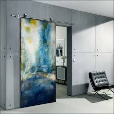 blue swirl contemporary art sliding interior door by sargram griffin between living room and bedroom