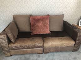 large 4 seater brown leather and cloth sofa