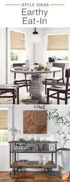 a round antique style dining table pairs beautifully with contemporary aluminum side chairs