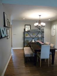dining room light fixture in white themed dining room with chandelier type made of silver metal hanging and transpa glass lamps in round shape