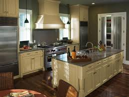 impressive kitchen decorating ideas. Pale Yellow Kitchen Cabinet With Wooden Floor For Impressive Decorating Ideas Grey Wall Color E