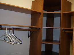 wooden hanger bars feat tall corner closet shelves design idea of