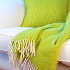 lime green wool throw and cushion cover by jodie byrne