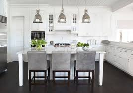 over island lighting. view in gallery traditional white kitchen with a large island and antique industrialstyle lighting over