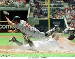 american colonial homes brandon inge: detroit tigers catcher brandon inge slides safe into home plate as minnesota twins catcher