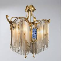a french art nouveau gilt bronze and glass chandelier from the re lumière collection by hector