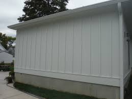 hardie board and batten siding. close-up of arctic white board \u0026 batten siding hardie and