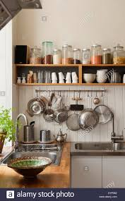 Open Shelving In Kitchen Dried Ingredients On Open Shelving And Utensils Hanging From A Pan