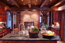 cherry kitchen cabinets black granite. dark wood ceiling beams with stone wall and black granite countertop plus cherry kitchen cabinets for modern design ideas