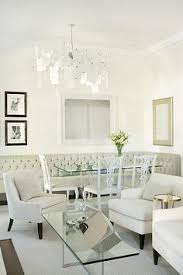sarah richardson design tufted banquet bench with dining room table white chairs white curvy chairs and white