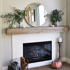 simple fireplace mantel with round mirror
