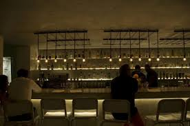 kitchen bar lighting. pslab was able to create alignment between the booths on opposite ends of each other by placing light fixtures within same axis kitchen bar lighting