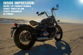triumphs in daytona riding the bobber scrambler and street
