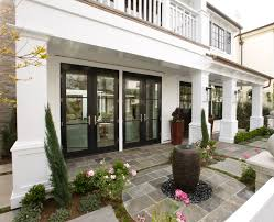 beautiful patio design with mirrored french doors and water feature
