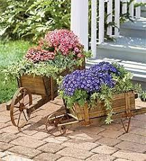 Decorative Garden Urns Decorative Solid Wood Wheelbarrow Planters with Functional Wheels 44