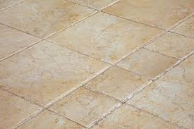 a tan colored ceramic tile floor