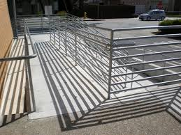 bar patio qgre: one of those ramps i avoid usually dizzy by the time i get to the top of it description metal pole ramp on a two level concrete incline