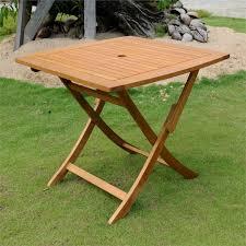 international caravan patio dining tables ttst038 the international caravan outdoor patio dining table is made from premium balau hardwood in a dual