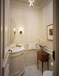 make full use of the limited space in a powder room by installing a vanity to