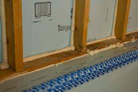 dow foam board sealed in stud bay cavity with spray foam