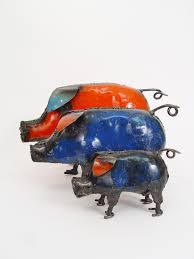 colorful recycled metal pig handmade from recycled oil drums in zimbabwe