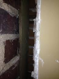 gap between plaster wall and brick wall