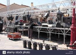sound lighting engineer setting up equipment on a stage gruissan edoc roussillon france