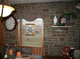 kitchen wall remodeled with ledgestone paneling for a french country farmhouse look