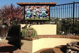 outdoor tv installed in outdoor tv motorized lift straight on view