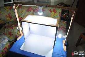place a light source in each hole you can use desk lamps in my case i built a wooden frame and ed in some led light bulbs diy lightbox 09