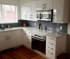 kitchen contemporary kitchen cabinets white gloss walls gray textured floor engineered hardwood soft green modern