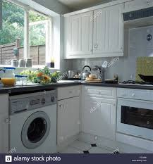 Laundry In Kitchen Oven And Washing Machine In Small Kitchen Stock Photo Royalty